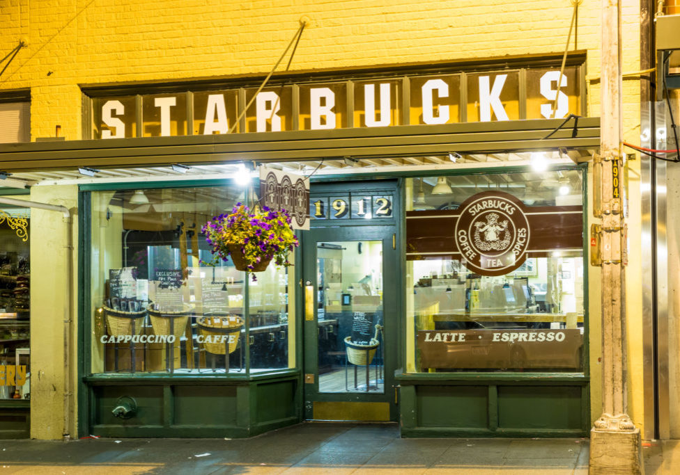 SEATTLE , USA - July 5, 2014: Original Starbucks store at 1912 Pike Place on July 5, 2014 in Seattle. Serving coffe in 20.891 stores in 62 countries, Starbucks is world's largest coffeehouse company.
