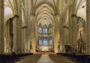 Regensburg, Germany - December 13, 2019: Interior of Regensburg Cathedral. The cathedral was built from 1275 to 1520. It has one of the most extensive surviving medieval stained glass windows in the German-speaking region.